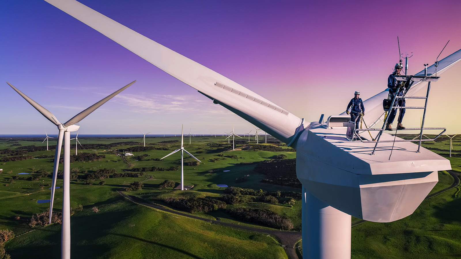 Engineers on top of a wind turbine