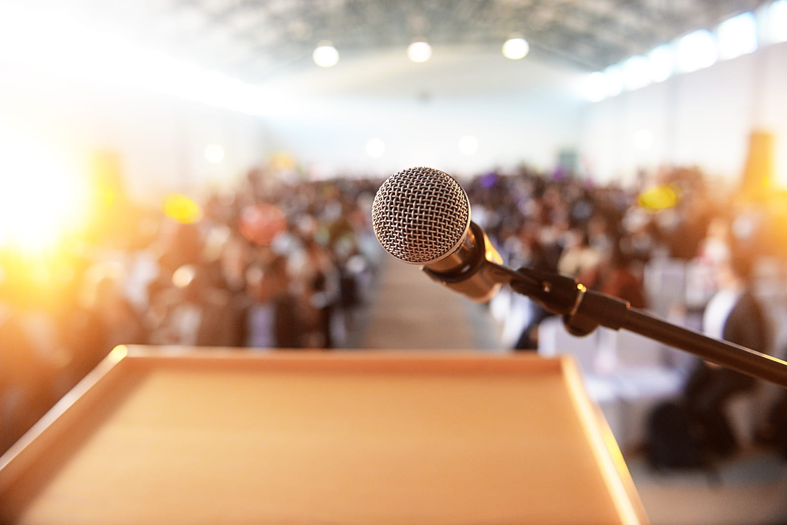 podium and microphone in front of a conference audience