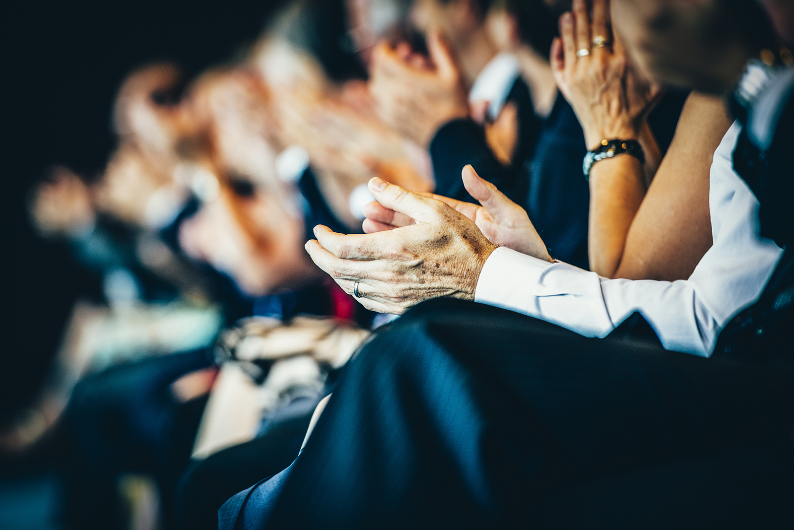 Audience clapping at a business conference