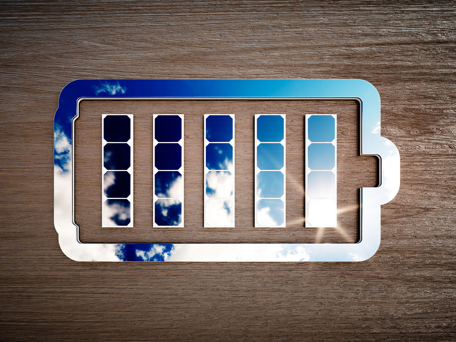 Battery symbol created from solar panels reflecting sky